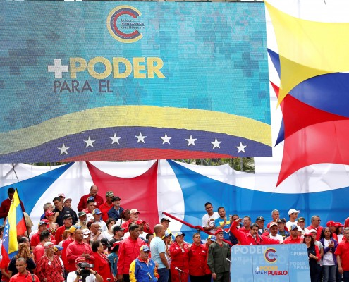 "FILE PHOTO: Venezuela's President Nicolas Maduro delivers a speech during the closing campaign ceremony for the upcoming Constituent Assembly election in Caracas, Venezuela, July 27, 2017 . The slogan at top left reads: ""More power to the people"". REUTERS/Carlos Garcias Rawlins/File Photo"
