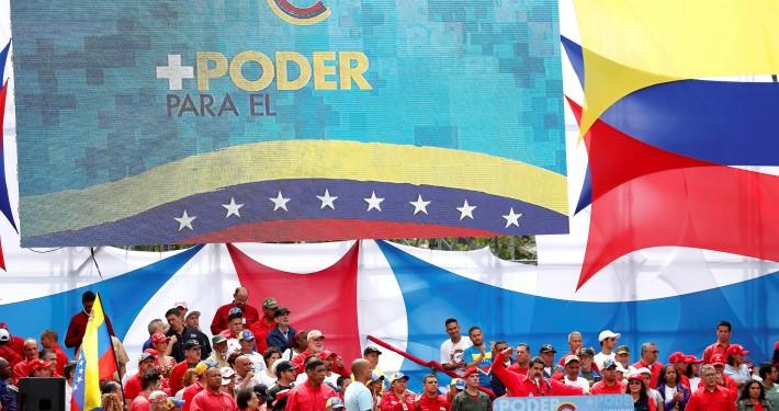 """FILE PHOTO: Venezuela's President Nicolas Maduro delivers a speech during the closing campaign ceremony for the upcoming Constituent Assembly election in Caracas, Venezuela, July 27, 2017 . The slogan at top left reads: """"More power to the people"""". REUTERS/Carlos Garcias Rawlins/File Photo"""